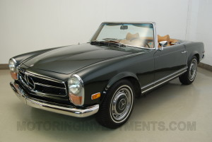 Image of dark olive Mercedes 280SL from the angle of the left front perspective